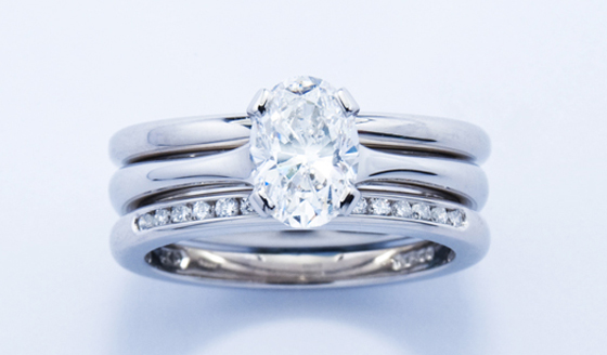 Platinum and diamond engagement, wedding and eternity ring set by Jon Dibben