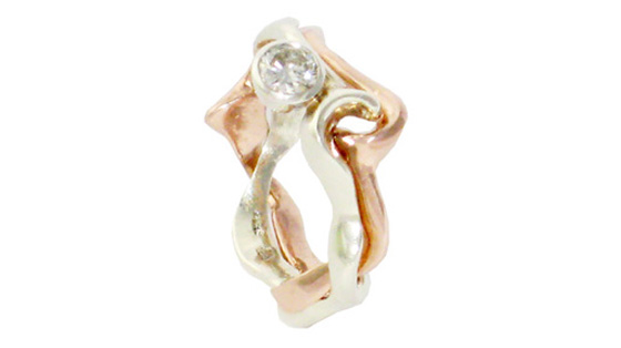 9 Ct interlocking rose and white gold ring set with a diamond by Daniel Gallie