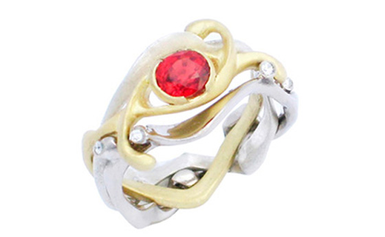 Interlocking eternity that combines 3 different gold bands set with a vivid Ruby and Diamond by Daniel Gallie