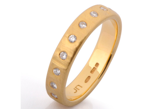 Medium eternity yellow gold brilliant diamonds by James Newman