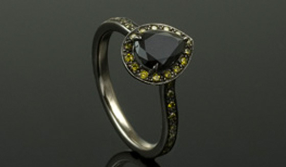 Black diamond engagement ring with yellow diamond sides by Anton Kata