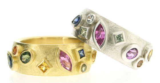 Silver and gold rings with coloured sapphires by Robert Feather